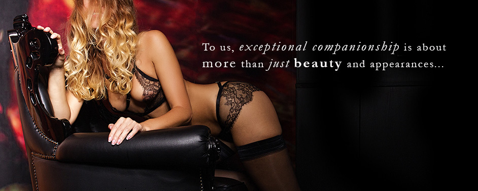 Beautiful smiling escort The Hague Kate in her beautiful black lacy lingerie from Pleasurements Amsterdam